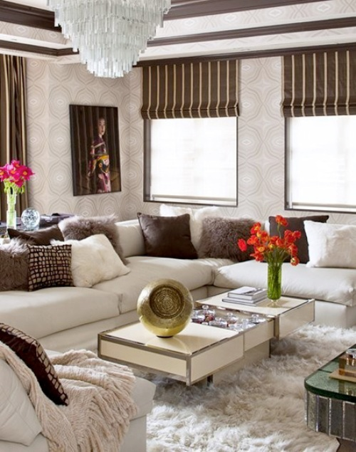 A Large Faux Fur Rug Is At Once Beautiful And Cozy Underfoot. Several  Decorative Pillows Also Add Appealing Furry Texture To The Sofa.